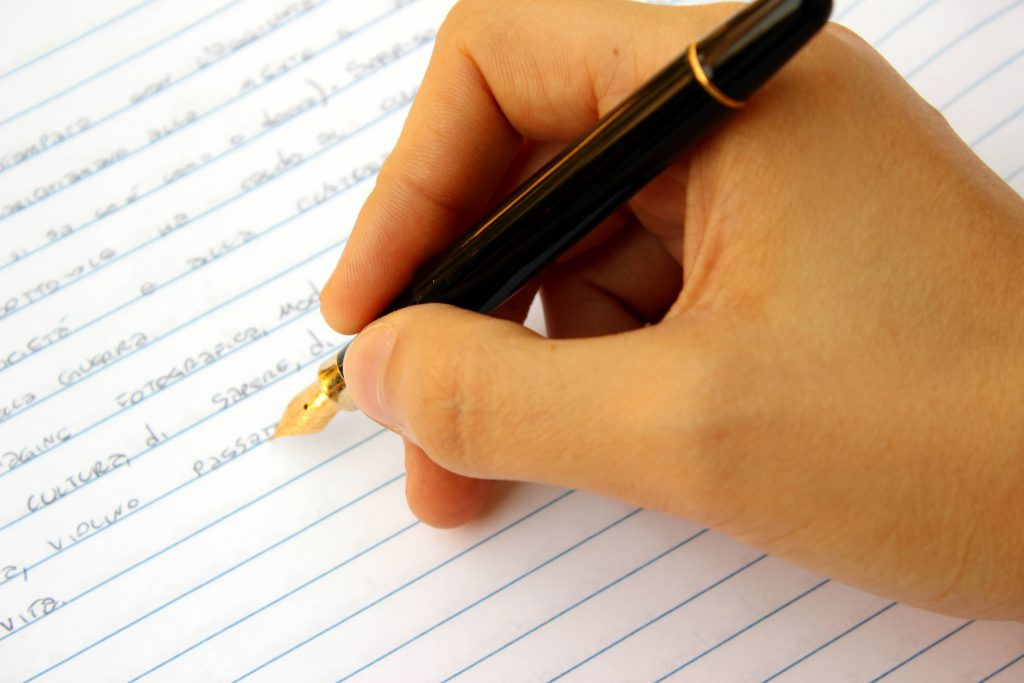 Image of pen and paper illustrating grant consulting services including grant writing and critiquing.